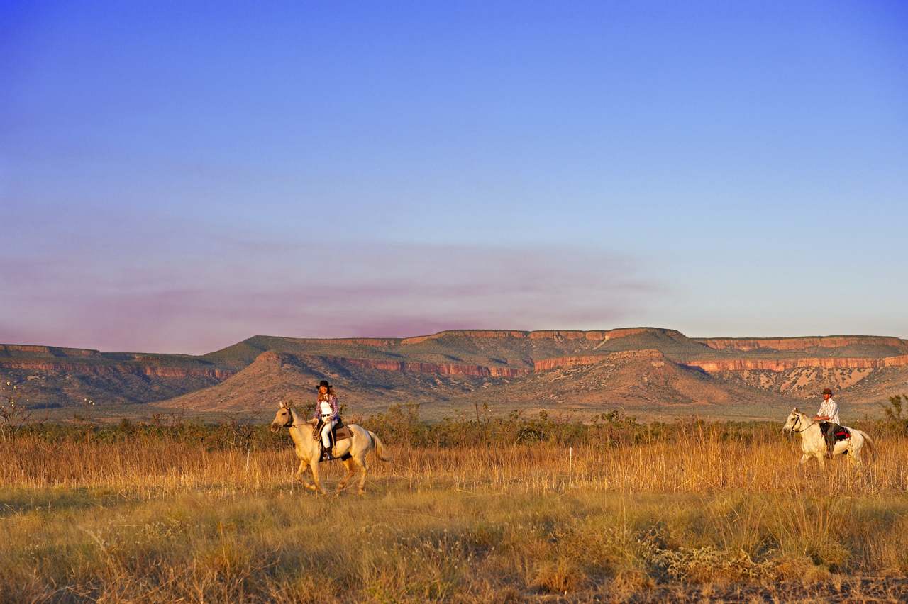Couple riding on Home Valley Station, located west of Kununurra