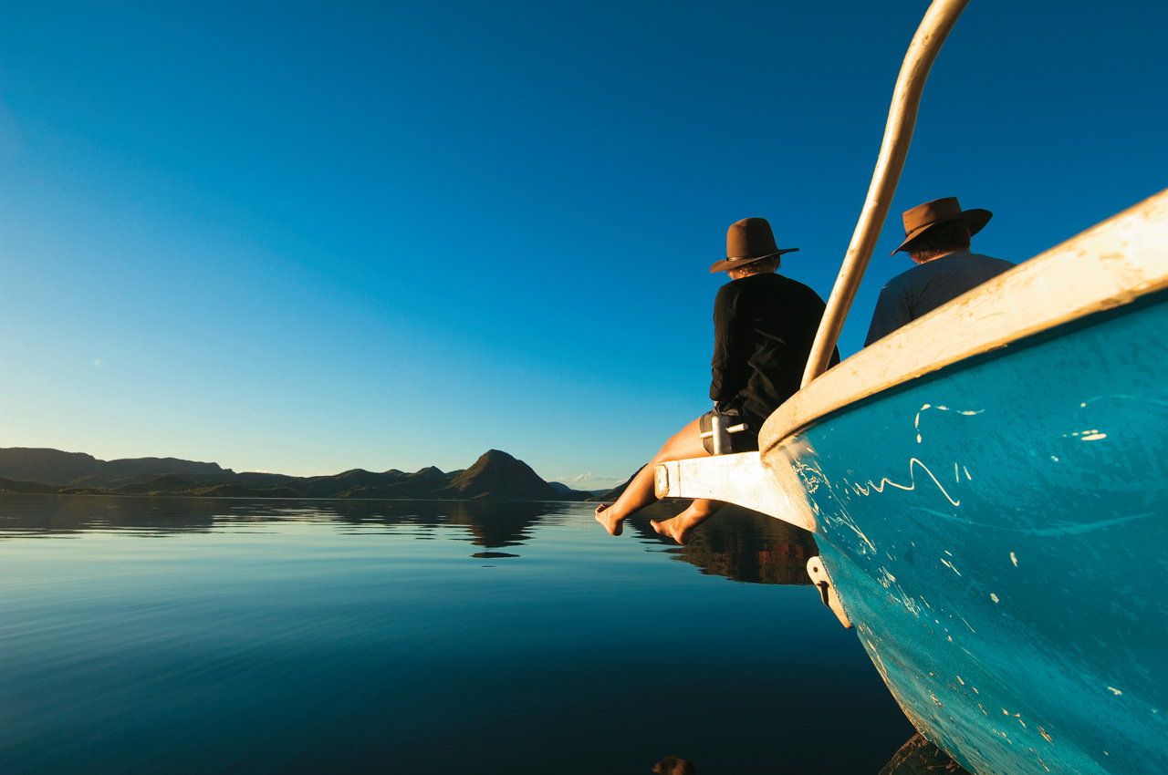 Couple sitting on boat on Lake Argyle